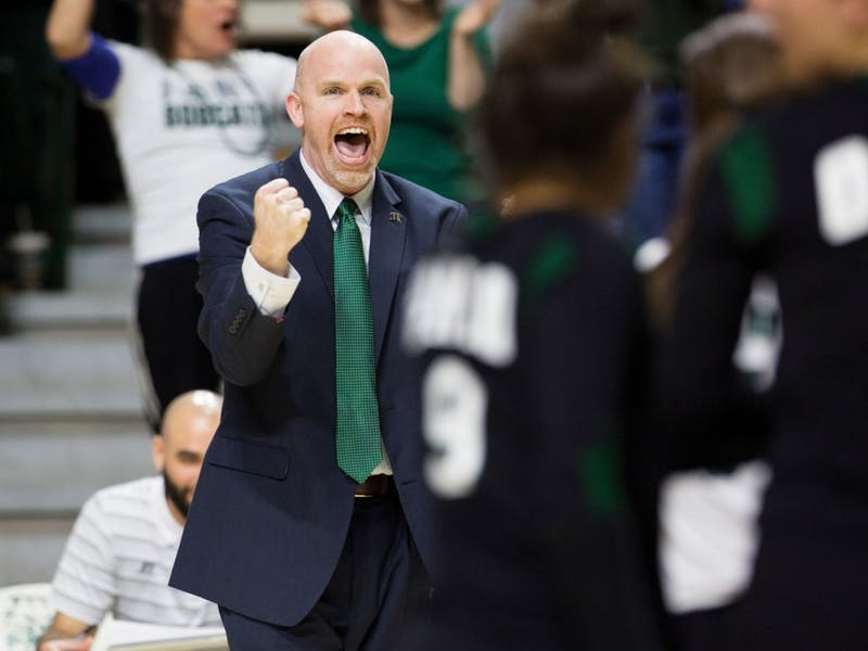 Ohio women's volleyball coach Deane Webb cheers during the final game of the MAC tournament, held in the Convocation Center in Athens, Ohio, on Sunday, November 22, 2015.