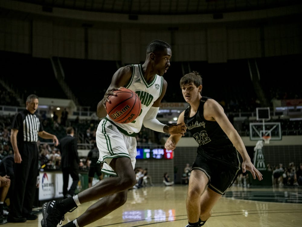 Ohio University forward Nate Springs (No. 2) drives toward the basket with pressure from Heidelberg University's Seth Hohman (No. 22) during the home game on Saturday, Nov. 9, 2019.