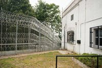 A yard connects two of the Hocking Correctional facility buildings. The facility is fenced in by two layers of barbed wire fences with a mangle of barbed wire in between to deter prisoners from escaping.