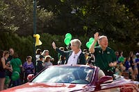 Ohio University First Lady Ruthie Nellis and President Duane Nellis wave during the annual homecoming parade on Saturday, Oct. 7, 2017.