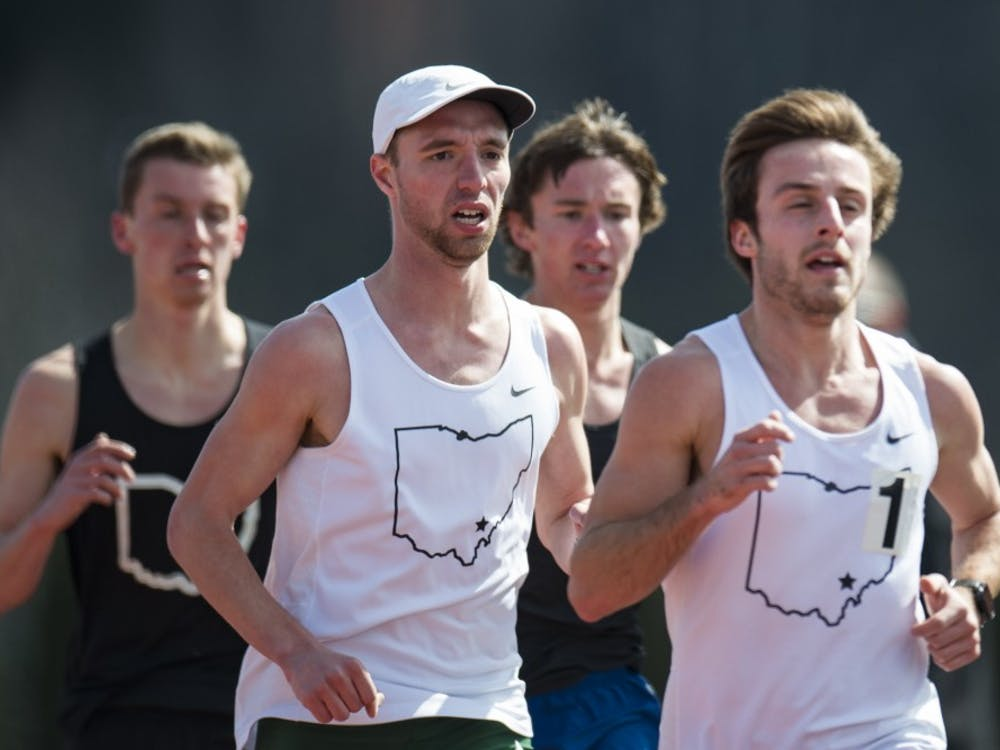 Ohio cross country's Brad Miller (middle) and Kyle Bussard run unattached during the mens 5000m at Ohio Track and Field's Cherry Blossom Invitational on April 7.