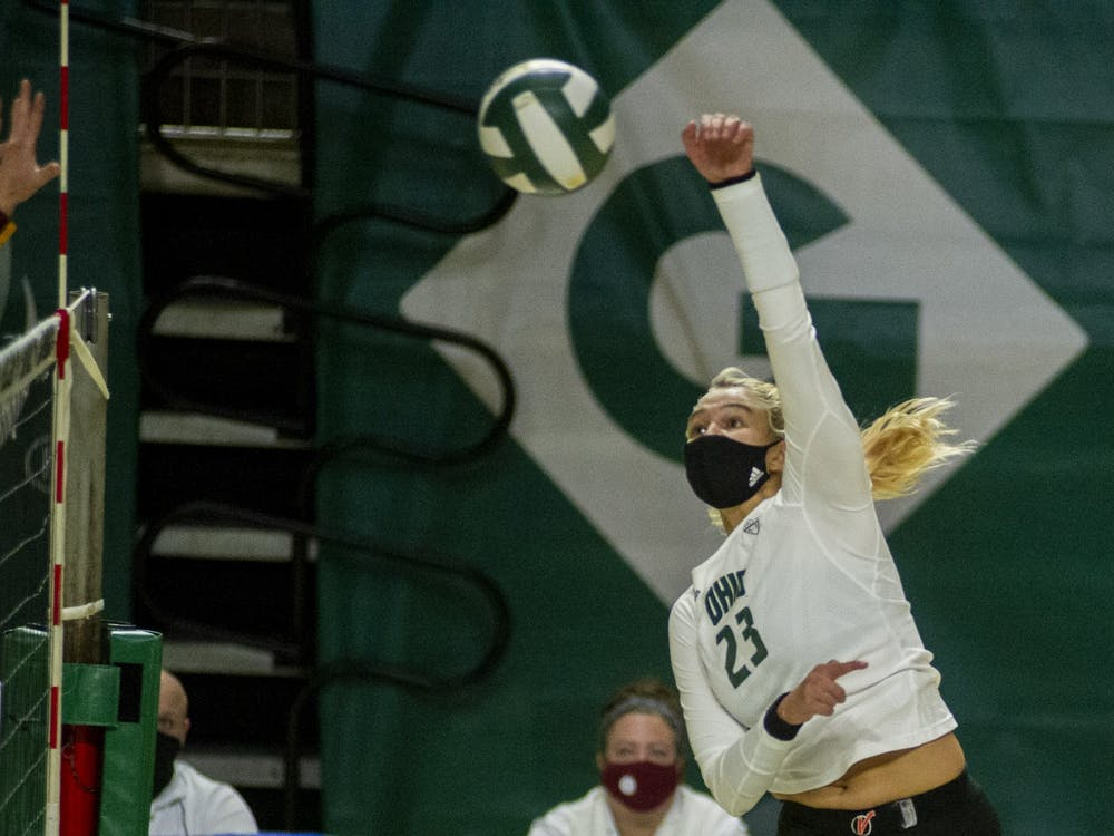 Ohio University's, Maggie Nedoma (23) hits the ball during the game against Central Michigan University on Friday, Jan. 22, 2021, in Athens, Ohio. The game was postponed due to the power outage and resumed Saturday.
