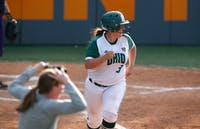 Natalie Alvarez watches her two-run home run clear the fence Saturday afternoon in an elimination game of the Knoxville Regional of the NCAA Tournament. (Photo courtesy via Ohio Athletics/Crystal LoGiudicd)
