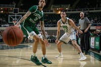 Ohio starter Gavin Block watches the ball pass Eastern Michigan's Ty Groce during Tuesday night's game against Eastern Michigan in The Convo.