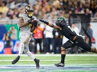 Corey Davis (84) beats Javon Hagan (7) over the middle at Ford Field in the 2016 Mid-American Conference Championship Game. Western Michigan won 29-23.