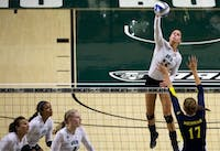 Jaime Kosiorek jumps up to spike the ball in Ohio University's afternoon match against Michigan on September 5, 2015. (FILE)