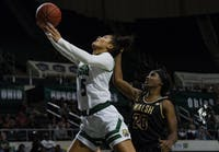 Ohio University guard, Caitlyn Kroll (#5), drives toward the basket with pressure from Quionche Carter (#20) during the bobcats home game on Saturday, Nov. 2, 2019.