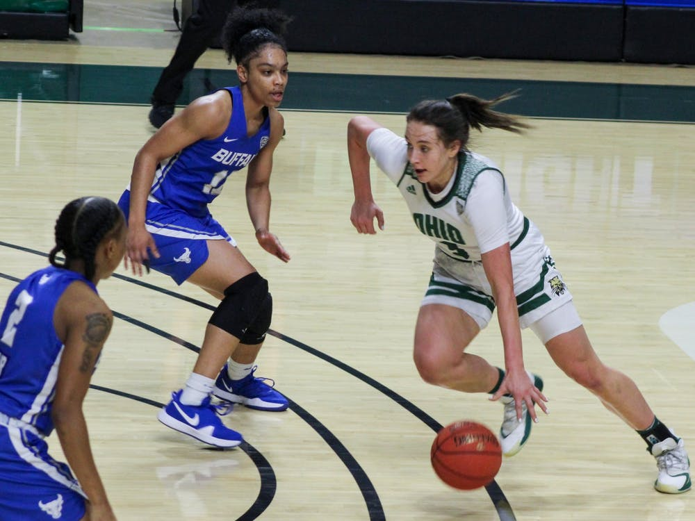 Ohio University guard, Madi Mace (3), attempts to take the ball to the basket with heavy defense from University at Buffalo players during the home game on Wednesday, Jan. 20, 2021.