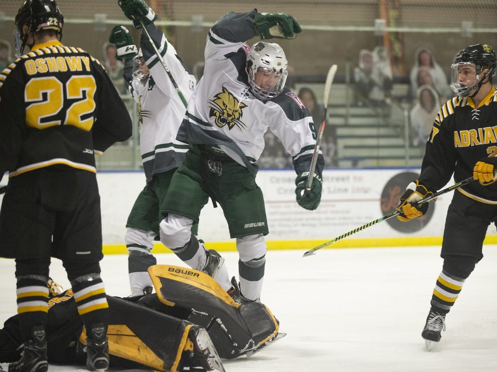 Ohio forward Kyle Craddick (#8) celebrates after scoring a goal during the Bobcats game against Adrian College on Friday, February 8, 2021, at the Bird Arena in Athens, Ohio. The Bobcats won the game 2-1.