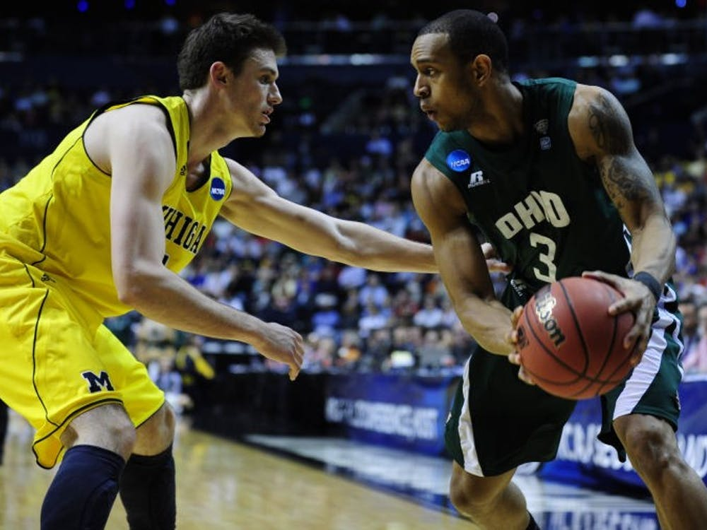 Ohio guard Walter Offutt tries to shake off a Michigan defender during the Bobcats' 65-60 win against the Wolverines in Friday's second-round game in the NCAA Tournament on March 17, 2012. (FILE)