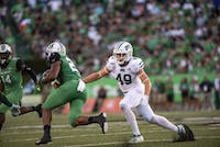 Ohio University line backer, Jared Dorsa (#49), attempts to tackle the Marshall University offense during the Battle for the Bell on Saturday, Sept. 14, 2019.