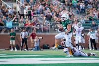 Bobcats running back A.J. Ouellette scores a touchdown during the game against UMass on Sept. 29, 2018.