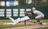 Tony Giannini slides back into first during Ohio's game against Marshall on April 18. The Herd beat the Bobcats 7-6.