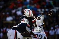 Ohio's Chukwudi Chukwa strips Virginia quarterback Bryce Perkins during the second quarter of the Bobcats' loss at Vanderbilt Stadium on Saturday.
