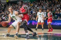 Ohio's Ben Vander Plas attempts to drive past Miami's Precious Ayah during the Bobcats' match in The Convo on Saturday, Feb. 8, 2020.