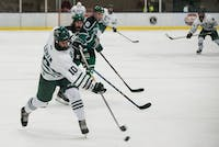 Senior forward Bryan Lubin (#10) shoots the puck during Ohio's game against Eastern Michigan on Saturday, October 13. The Bobcats defeated the Eagles 8-1. (FILE)
