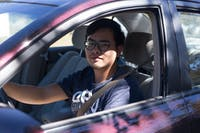 Tianhao Zhu, a second year master's student studying food and nutrition science, poses for a portrait in his car. (HANNAH SCHROEDER | PHOTO EDITOR)