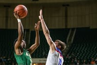 Athens' Elijah Williams attempts a shot while Zane Trace's Colby Swain attempts a block during the game on Thursday.