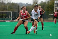 Ohio University's MF Emma Spinetto (7) aims to hit the ball away from Ohio State's MF Genevieve Penzone (5) at Pruitt Field on Sunday, Oct. 6 2019.