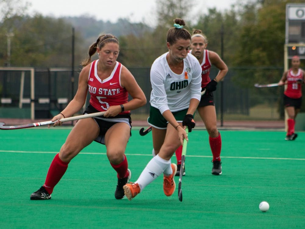 Ohio University's MF Emma Spinetto (7) aims to hit the ball away from Ohio State's MF Genevieve Penzone (5) at Pruitt Field on Sunday, Oct. 6 2019.