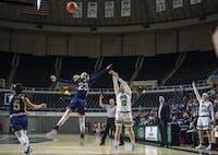 Senior, Dominique Doseck, shoots a three pointer against Kent State.