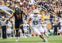 Senior running back, A.J. Ouellette, runs a ball during the game against Kent State on Oct 6.