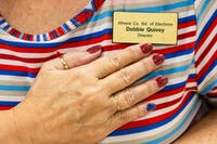 Debbie Quivey, director of Athens' Board Of Elections, shows her patriotic manicure on Tuesday, November 6, 2018. Quivey has been director of the Board of Elections for 13 years and says her favorite part of Election Day is taking care of the absentee ballots. (Midge Mazur | The Post)