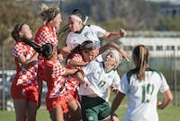 Ohio and Bowling Green collide after an Ohio corner kick. After double overtime, the Bobcats tied 1-1 with the Falcons on October 19, 2017. (Emilee Chinn | For The Post)