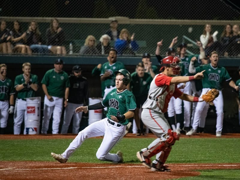 Ohio's Michael Richardson (#8) slides into home plate during the home game against Ohio State on April 9. The Bobcats lost to the Buckeyes 10-8.
