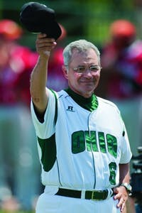 Former baseball coach Joe Carbone lifts his hat to bid the crowd farewell before the start of his last regular season home game before retirement. Carbone finished his 24th and final season with Ohio in 2012. (Robin Hecker | File Photo)