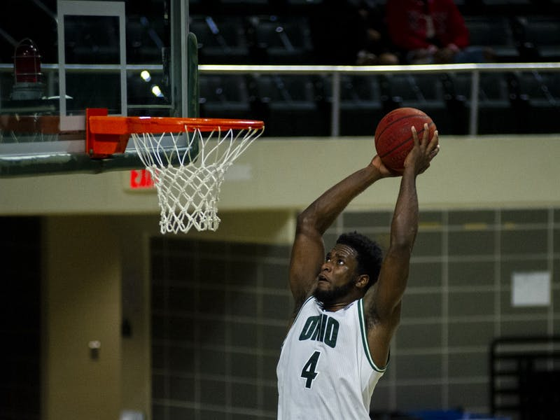 Ohio University's Dwight Wilson III (4) dunks the ball during the home game against Ball State in Athens, Ohio, on Saturday, Jan. 23, 2021. The game was postponed from Friday due to a power outage.