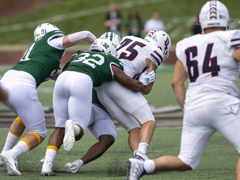 Ohio's Bryce Houston (#32) tackles Duquesne's Max Baker (#75) during the Ohio versus Duquesne match in Peden Stadium on Saturday, Sep. 11, 2021. Ohio lost 28-26.