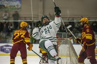 Ohio forward Matt Rudin (#27) celebrates after scoring a goal during the first period of the Bobcats' game against the Cyclones on Friday, Feb. 15.