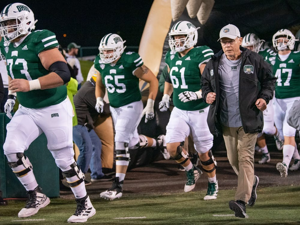 Ohio University football coach Frank Solich enters the field with the Ohio football team before the game versus Miami on Wednesday, November 6, 2019, at Peden Stadium. (FILE)