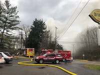 Fire crews respond to a fire at 230 N. Lancaster St. on Wednesday.
