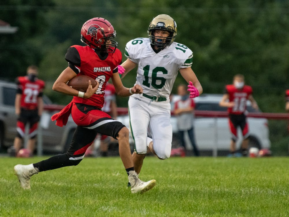 Alexander's Michael Lash II attempts to run the ball past Athens' Braxton Springer during the game at Alexander High School on Friday, Aug. 28, 2020. Athens beat Alexander 20-13. (FILE)