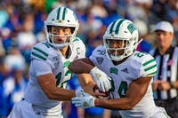 Ohio's QB Nathan Rourke (12) hands the ball to RB De'Montre Tuggle (24) in the third quarter of the first Mid-American Conference against the Buffalo Bulls in Buffalo, NY on Friday, Oct. 5, 2019.