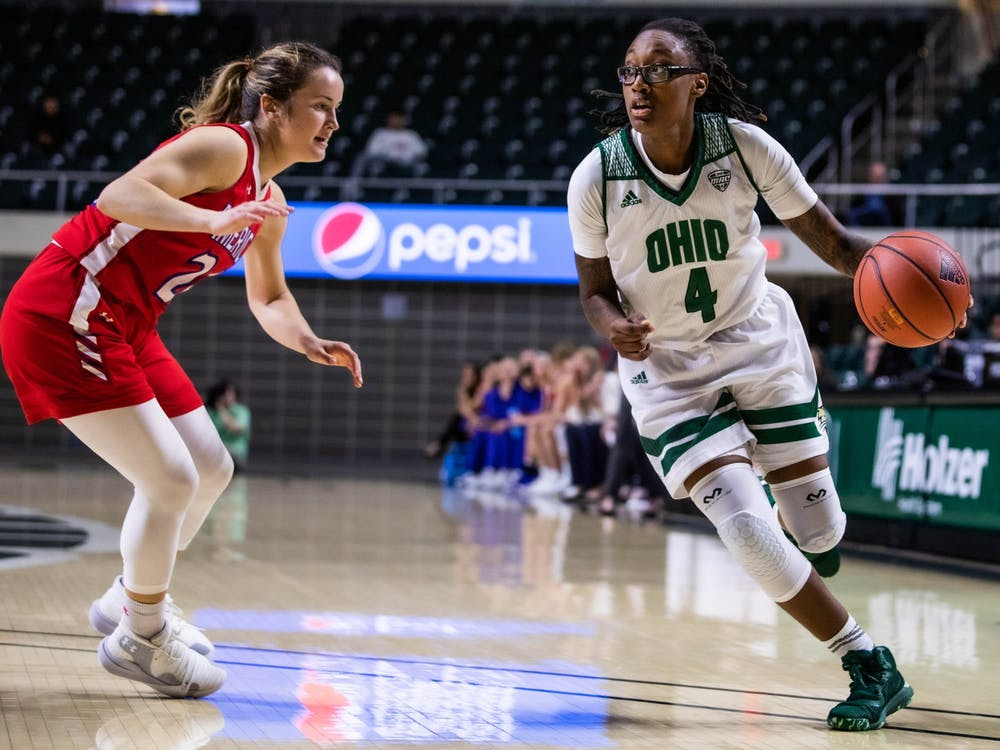 Ohio's guard Erica Johnson (No. 4) runs past American University's guard Laura Graytok (No. 24) for a layup in a game held at The Convo on Sunday, Nov. 10, 2019.