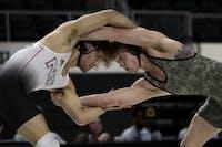 Northern Illinois' Mason Kauffman and Ohio University's Kade Kowalski position themselves during their match in The Convo on Sunday, Feb. 9, 2020.