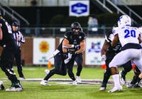 Ohio running back A.J. Ouellette takes a handoff during the second half of the Bobcats' game against Buffalo on Wednesday night.