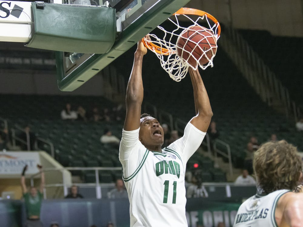 Ohio's Sylvester Ogbonda (no. 11) goes for a dunk against Central Michigan University.They won the game 77-69 in the Convo on Tuesday, Feb, 18th, 2020.