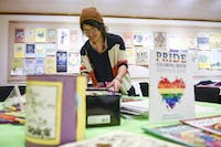 Tessa Evanosky, events coordinator for ARTS/West, sets up for a PRISM meeting on Wednesday, January 24, 2018. PRISM is an after-school program aimed at local LGBT youth and allies aged 12-18 that is held on Wednesday's from 3-5:30 PM.