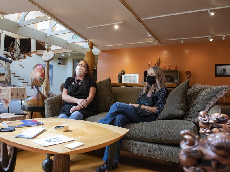 Betsy Caul (left) and Kait Runevitch (right) sit for an interview in the home of late artist David Hostetler. Caul and Runevitch are partners in their work for Art Park Custom Framing and Design, which they operate out of Hostetler's home.