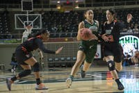 Ohio's Amani Burke maneuvers around the defense during the Bobcats' game against Bowling Green on Feb. 17. (FILE)