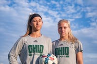 Ohio's attacking midfielder Alivia Milesky (left) and forward Abby Townsend (right) pose together at Chessa Field in the sunrise of Wednesday, Sept.11, 2019.