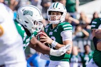 Ohio's QB Nathan Rourke (12) readies himself to throw the ball in a play against Kent State at Peden Stadium on Saturday, Oct. 19, 2019.