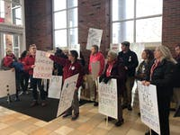 The protest group was led by the OU chapter of the American Association of University Professors, or AAUP, who has been vocal in the recent conversation at the university about cutting faculty.
