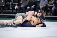 Aaron Naples holds down Shane Mast during Ohio's dual against Kent State on Friday, Jan. 18, 2019. The Bobcats defeated the Golden Flashes 24-12.