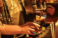 Lead bartender Joshua Novak fills a glass with beer at Jackie O's Pub and Brewery on November 28.