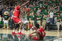 Ohio's Lunden McDay attempts to shoot the ball past Miami's Bam Bowman (#14) and Isaiah Coleman-Lands (#4) during the Bobcats' match on Saturday, Feb. 8, 2020.